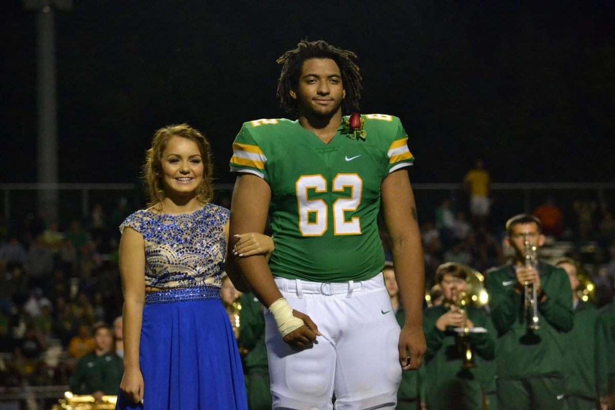 Adrianna Gutierrez and Evan Clark stand together as homecoming candidates.