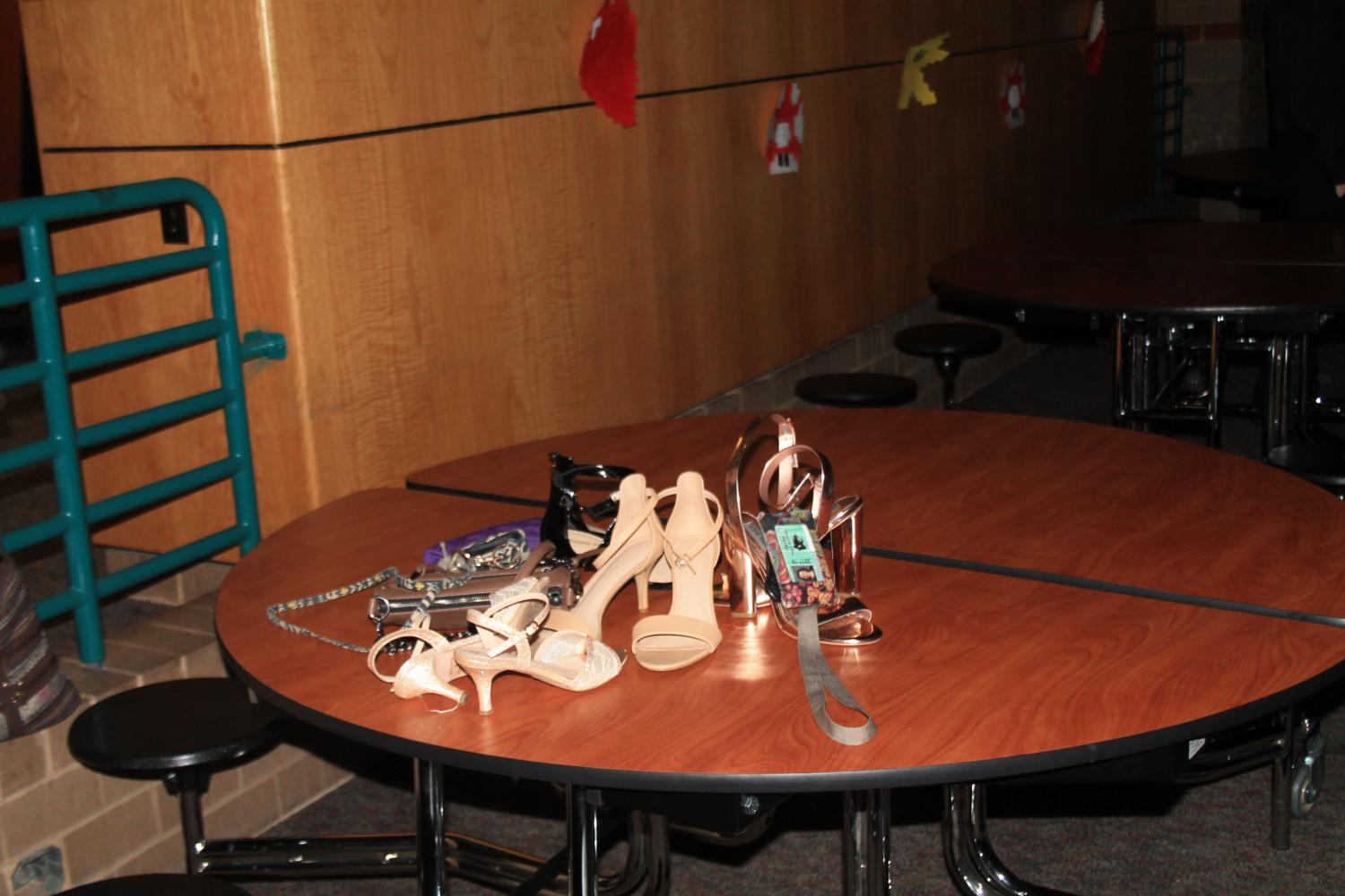 Heels, accessories, and IDs left on a table.