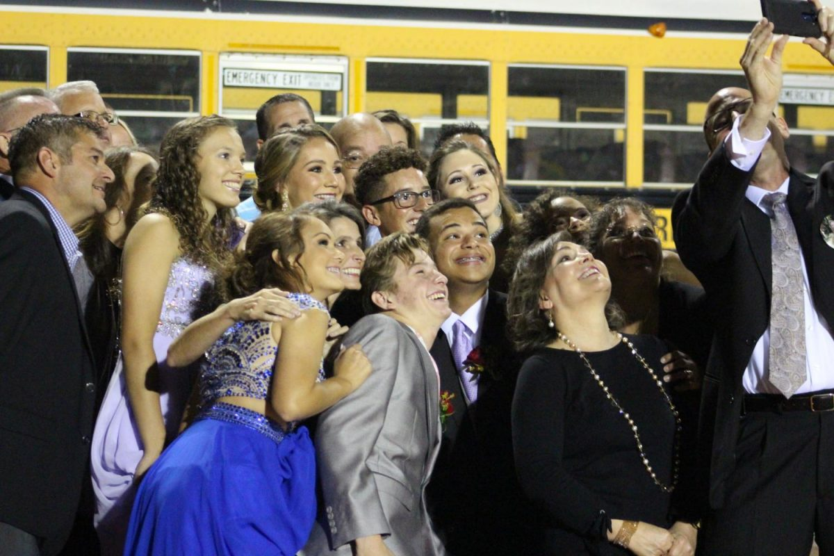 Homecoming+nominees+and+family+take+a+selfie+before+the+ceremony+at+half+time