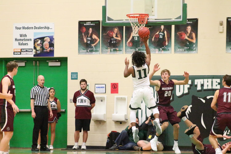 Boys basketball photo gallery vs. Salina Central (Photos by Reagan Cowden)