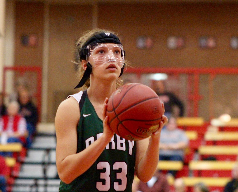 Senior+Holly+Mills+prepares+to+shoot+her+free-throw+at+the+McPherson+basketball+game.