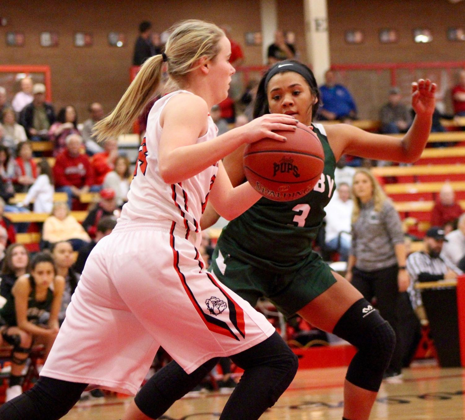 Junior+Aliyah+Meyers+thinks+about+how+to+get+the+ball+from+her+opponent.