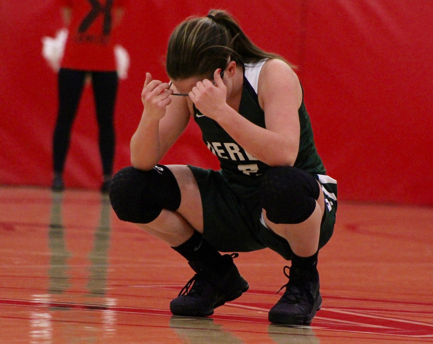 Junior+Madi+Young+kneels+down+towards+the+end+of+the+game+to+regain+her+focus.