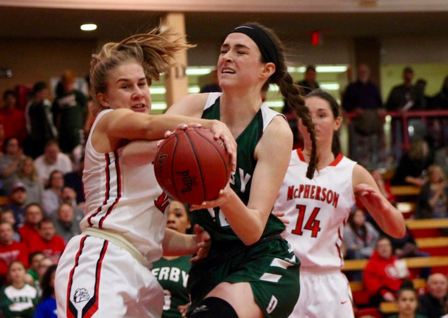 Junior+Kennedy+Brown+fights+to+keep+the+ball+in+her+possession+in+McPherson+territory.