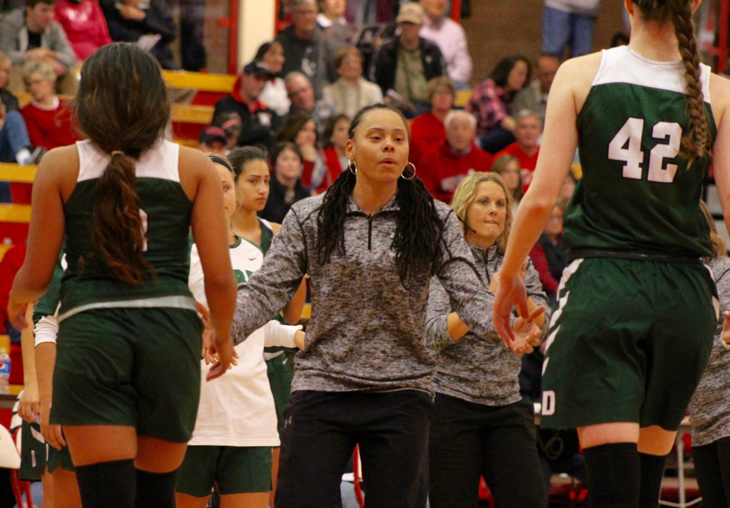 Coach+Jessica+Diamond+sticks+her+arms+out+for+high+fives+as+juniors+Aliyah+Meyers+and+Kennedy+Brown++come+in+for+a+timeout.