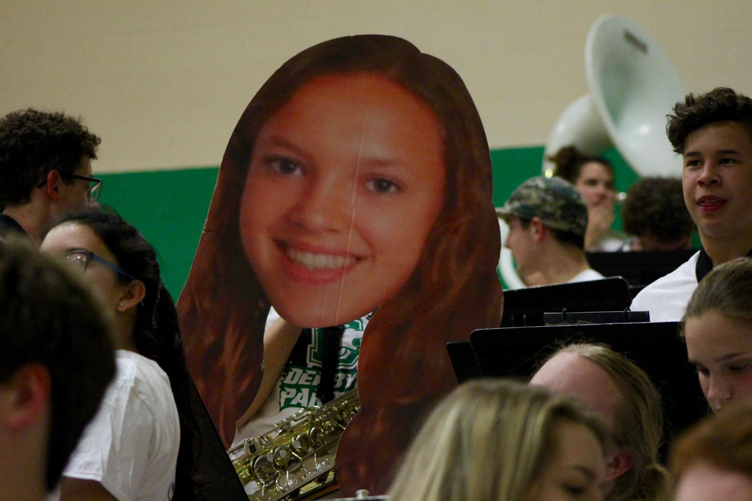 The+Derby+High+Basketball+Band+holds+a+fathead+of+senior+Holly+Mills.+Mills+was+apart+of+the+Marching+Band.