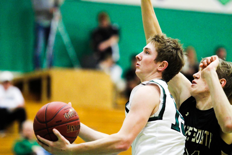 Sophomore Grant Adler goes for a layup.
