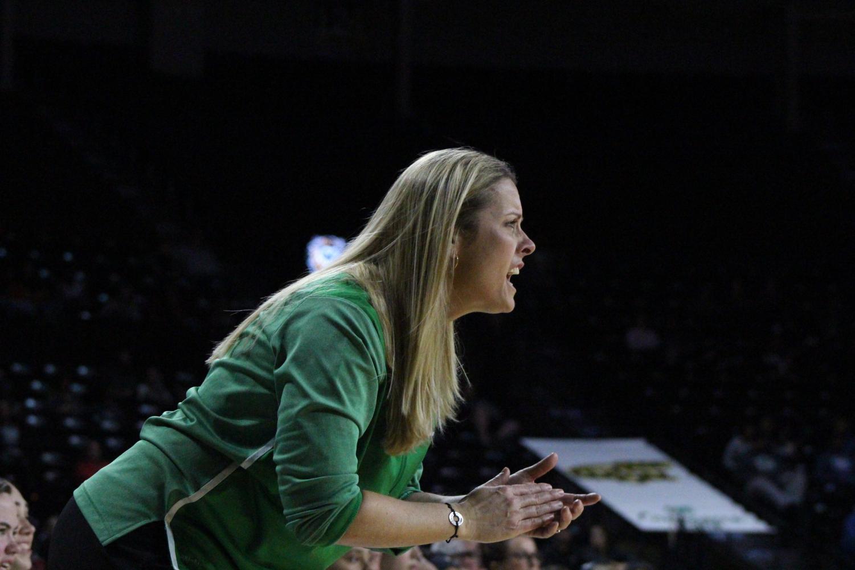 Coach+Jodie+Karsak+yells+in+excitement+at+her+team