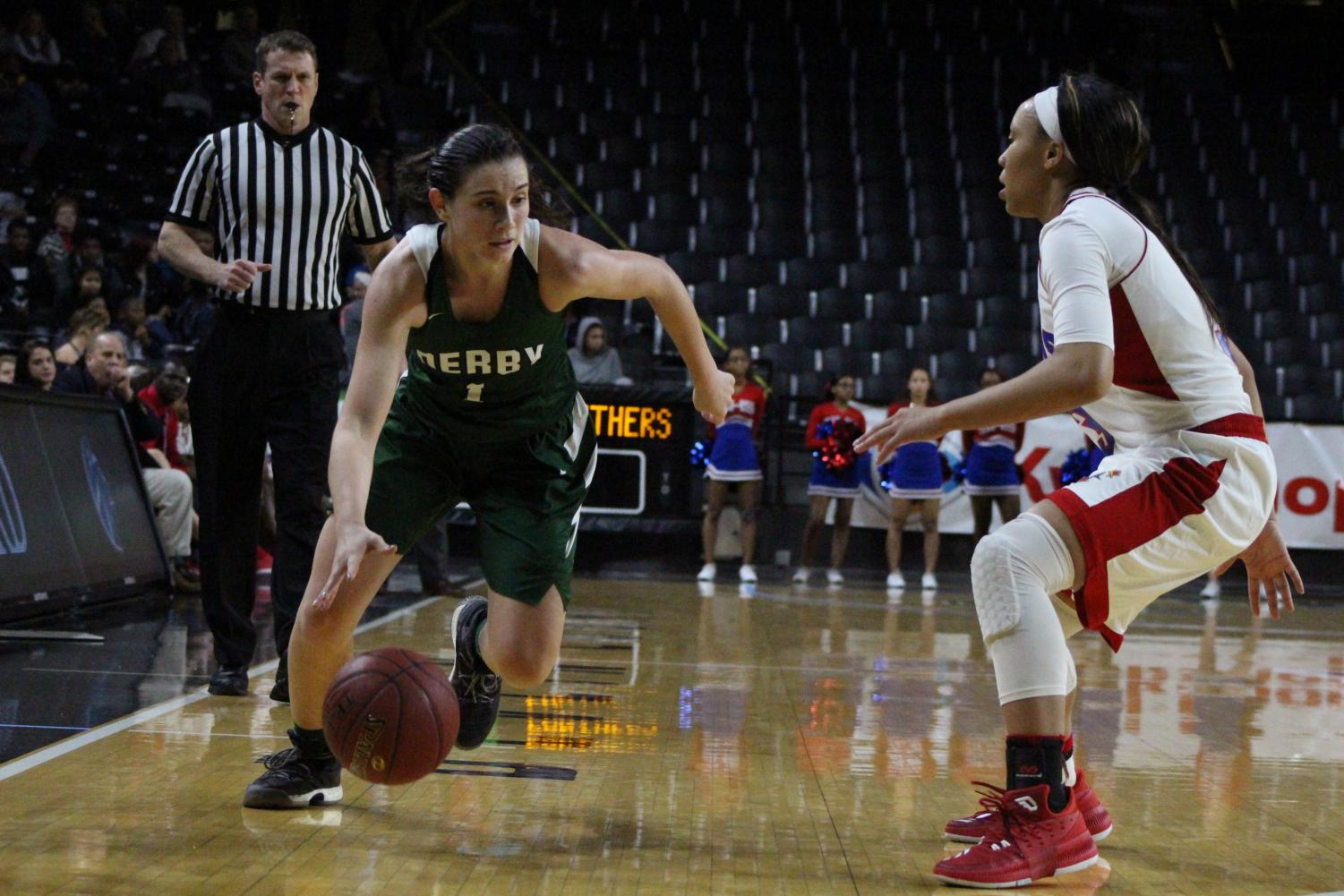 Sophomore+Sydney+Nilles+prepares+to+dribble+past+her+opponent.