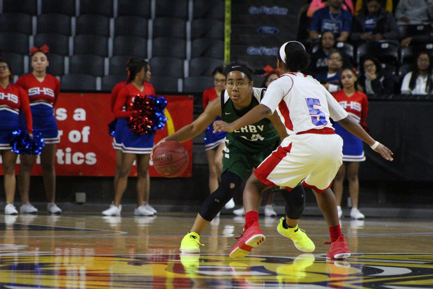 Junior Tor'e Alford switches up her dribble, tricking her opponent.