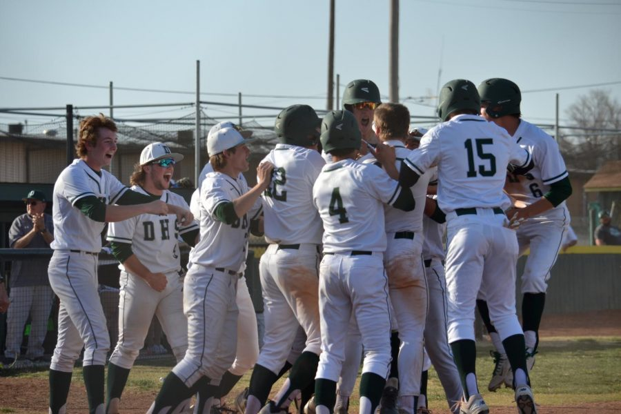 The+team+celebrating+after+the+walk-off+grand+slam+from+Coleson+Syring+that+won+the+game+10-8.
