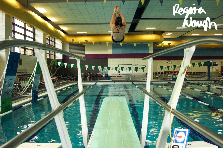 Freshman+Sophia+DiGregorio+dives+at+the+Derby+home+swim+meet.