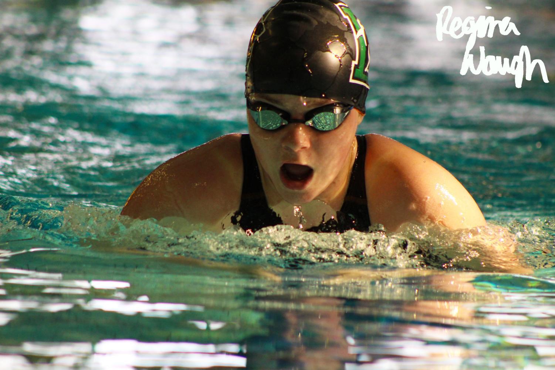 Senior+Ashlee+Henwood+inhales+while+swimming+breaststroke.