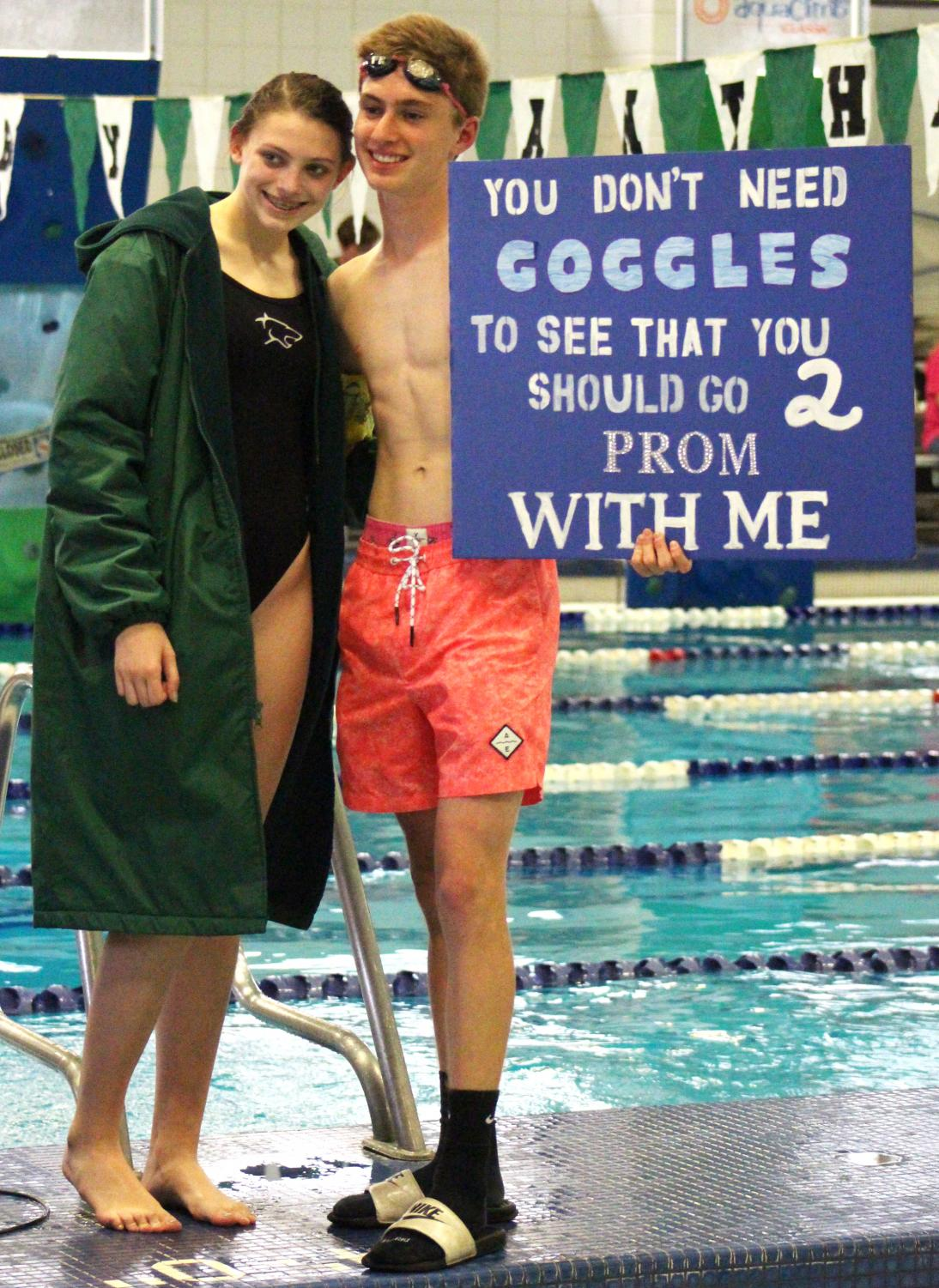 Junior+Clayton+Simmons+with+his+swim+themed+promposal+for+sophomore+Presley+Brunecz.