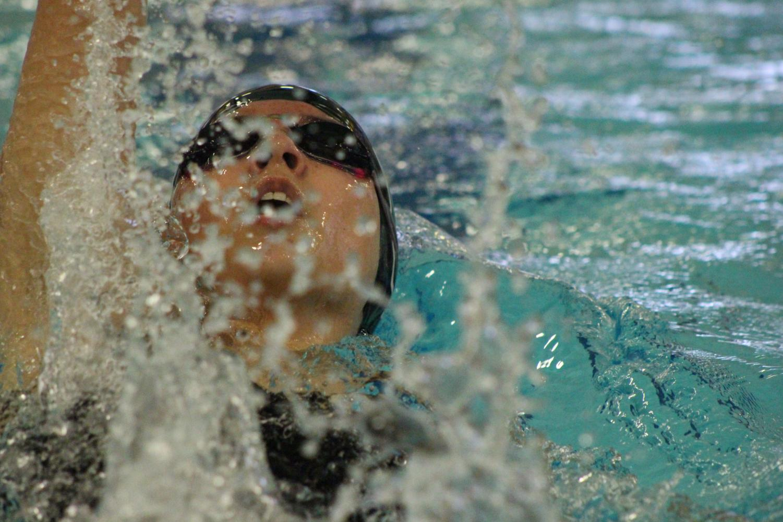 Junior+Alyssa+Gamboa+swimming+backstroke.