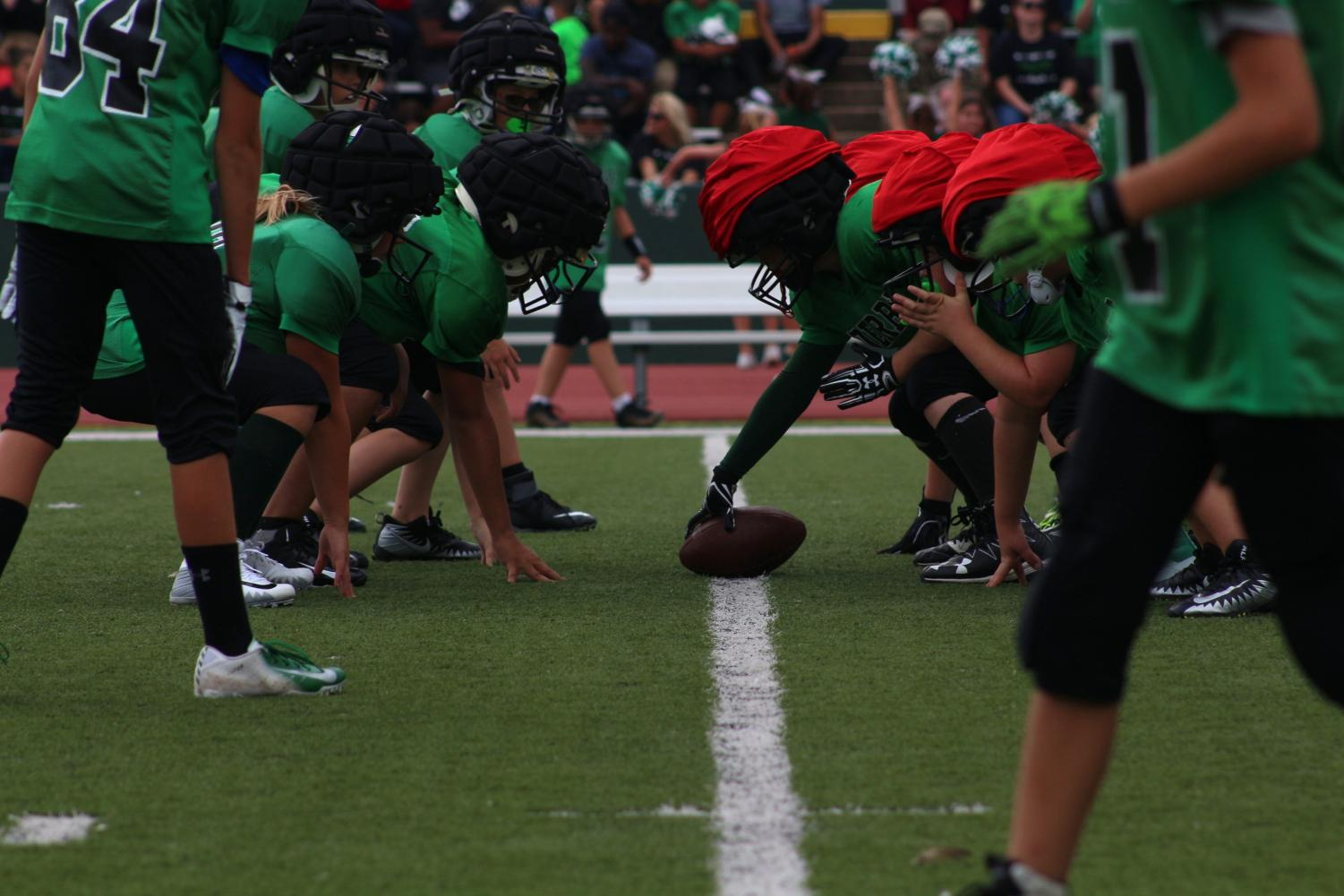 Derby Junior Football Players lining up getting ready to snap the ball.