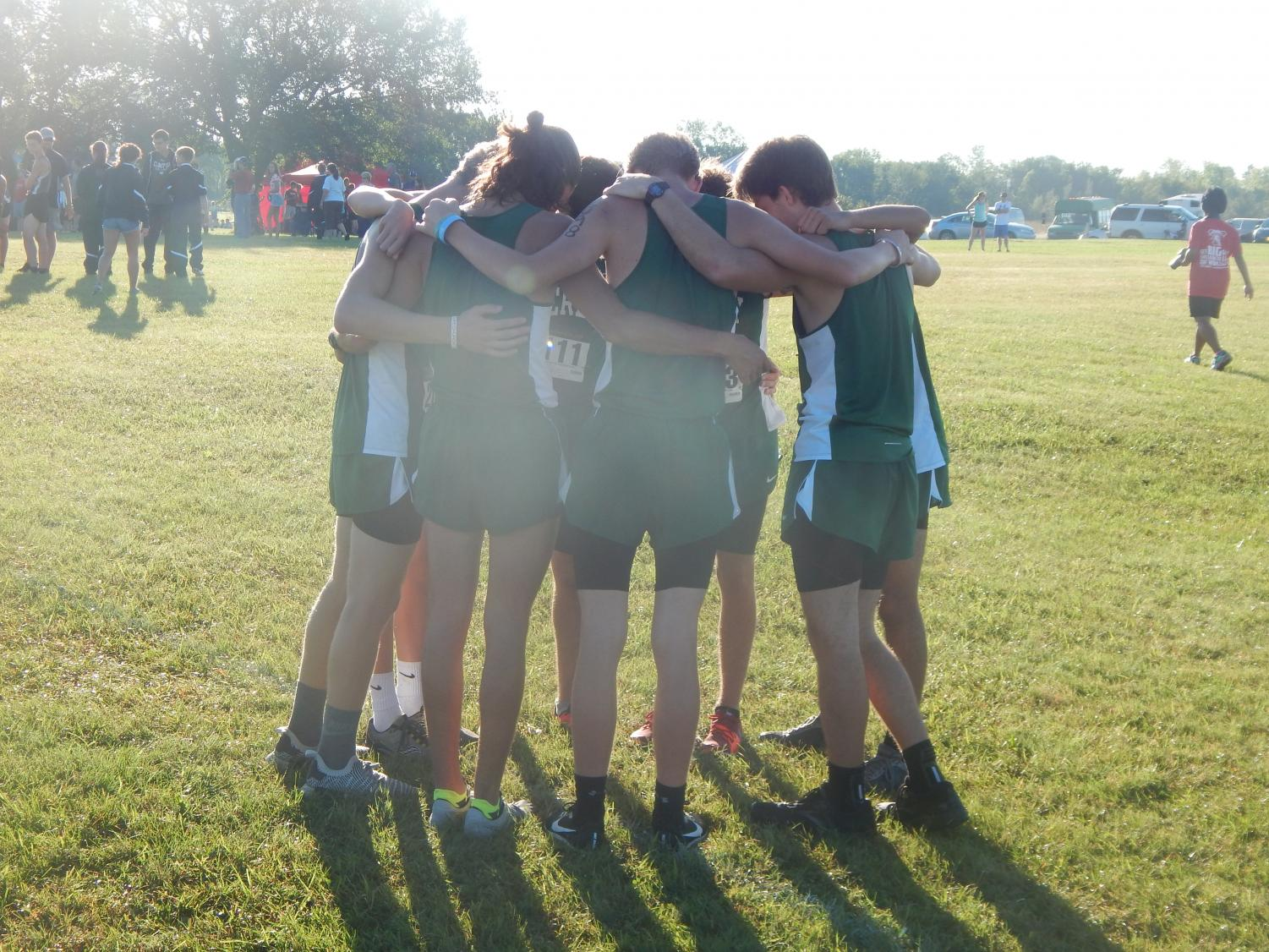 After the runners do their warm ups they do a team huddle in preparation for their upcoming race