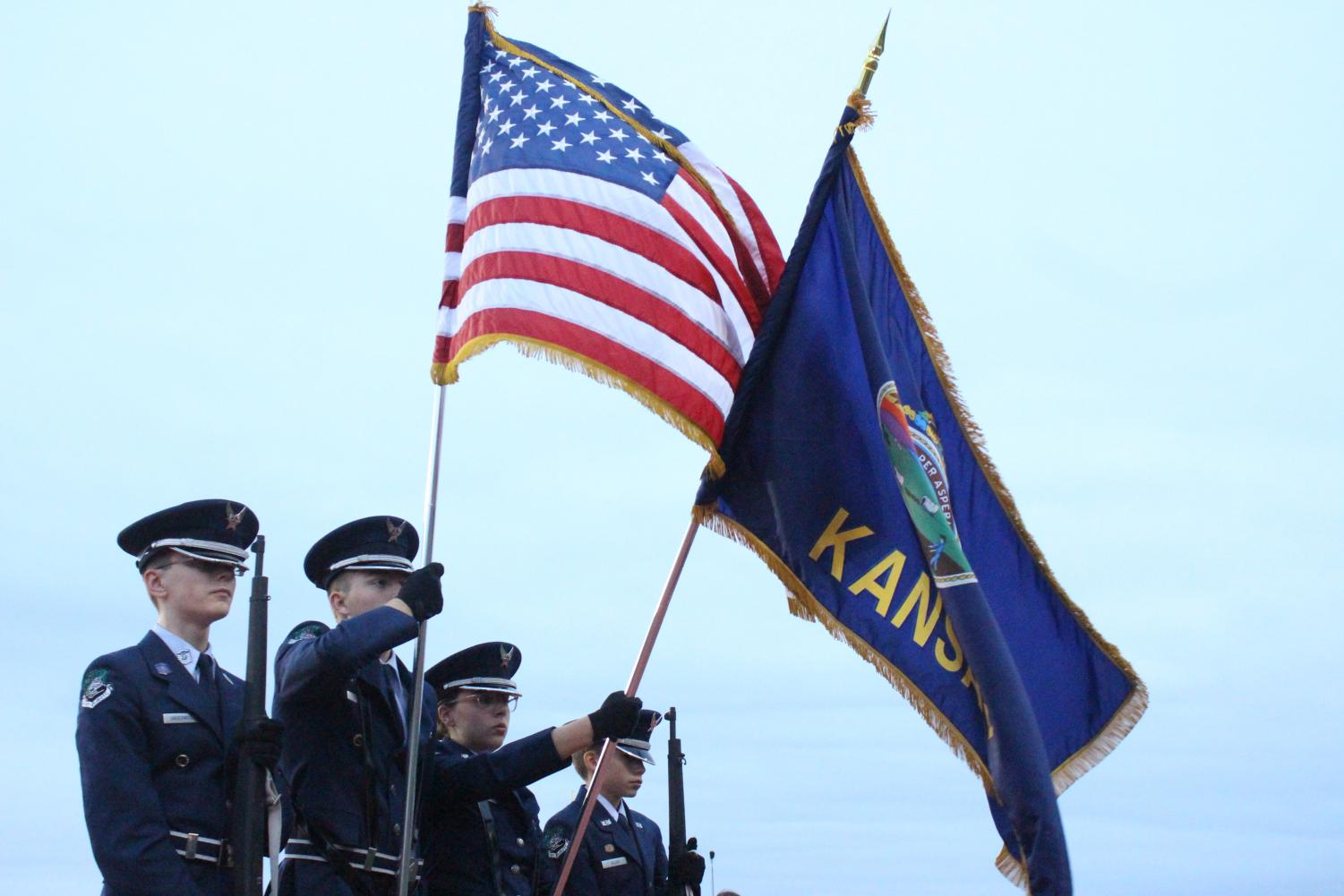 AFJROTC+color+guard+members+Stockton+Underwood+%28left%29%2C+Connor+Grosso%2C++Natalie+Knowles+and+Charles+Allen+present+the+colors+before+the+game+starts.