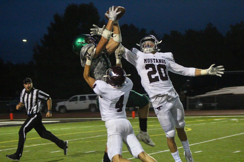 Junior Jacob Karsak jumps to catch a pass.