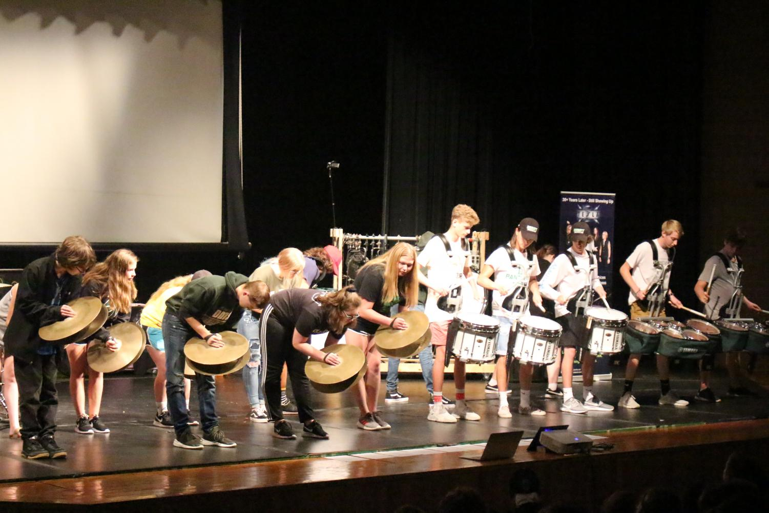 The Derby drumline plays with Tesla drummer Troy Luccketta.