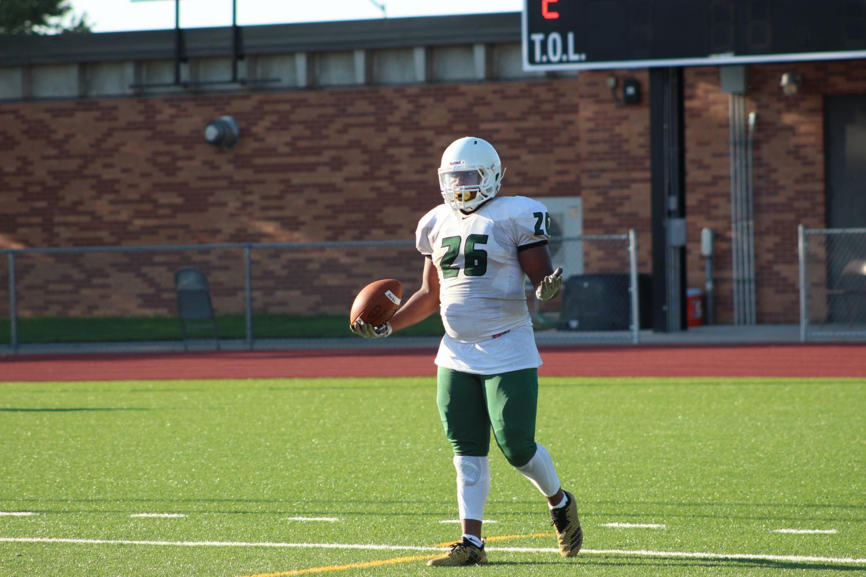 Freshman Zechariah Bryant after he scores a touchdown.