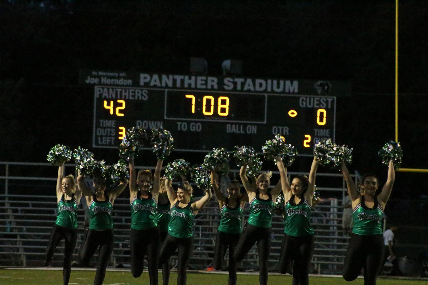 The Pantherettes perform at halftime, with Derby winning 42-0.