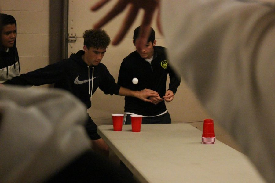 Scott+Simmmons+and+Dylan+Hildreth+watch+as+a+ping+pong+ball+is+thrown+during+the+Derby+soccer+team+dinner.+