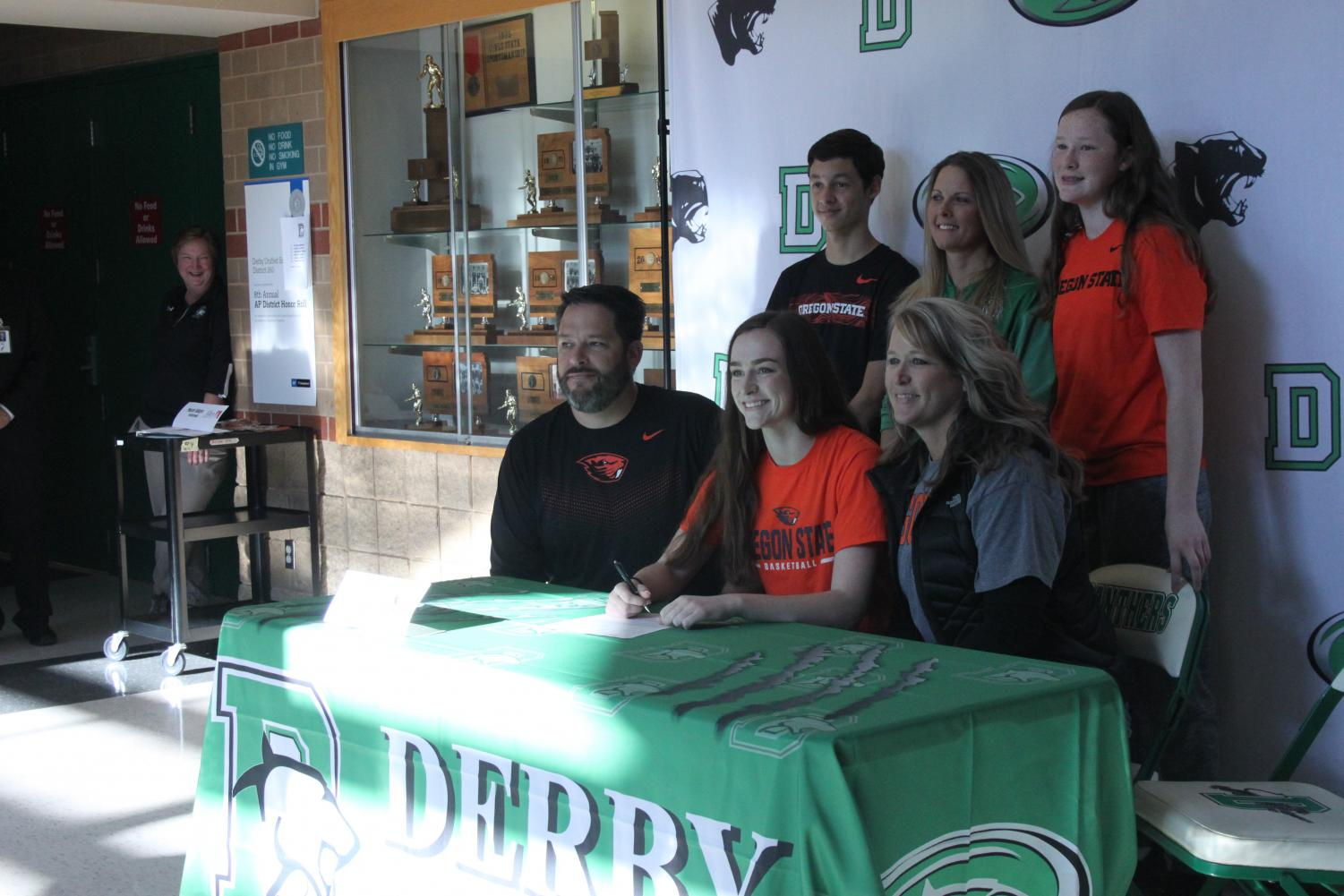 Kennedy Brown and her family as she signs her Basketball Contract with Oregon State.