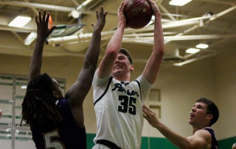 12/4 Boys basketball vs. Ark City photo gallery by Regina Waugh