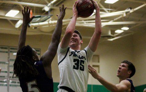 12/4 Boys basketball vs. Ark City photo gallery by Regina Waugh