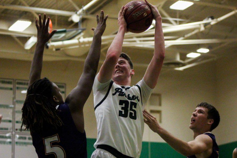Senior+Joshua+Osborn+jumps+toward+the+basket.