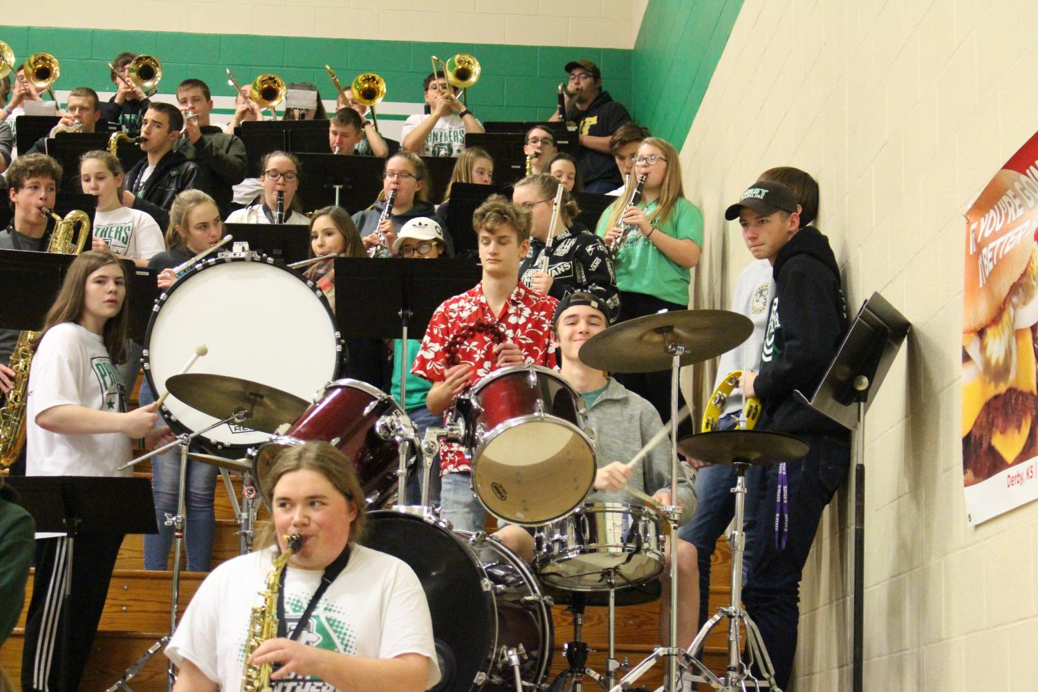 Derby+High+School+Basketball+Band+plays+at+Panther+Pal%27s+game.+Drummer%2C+sophomore+Nathan+Jolly+smiles+at+the+camera.