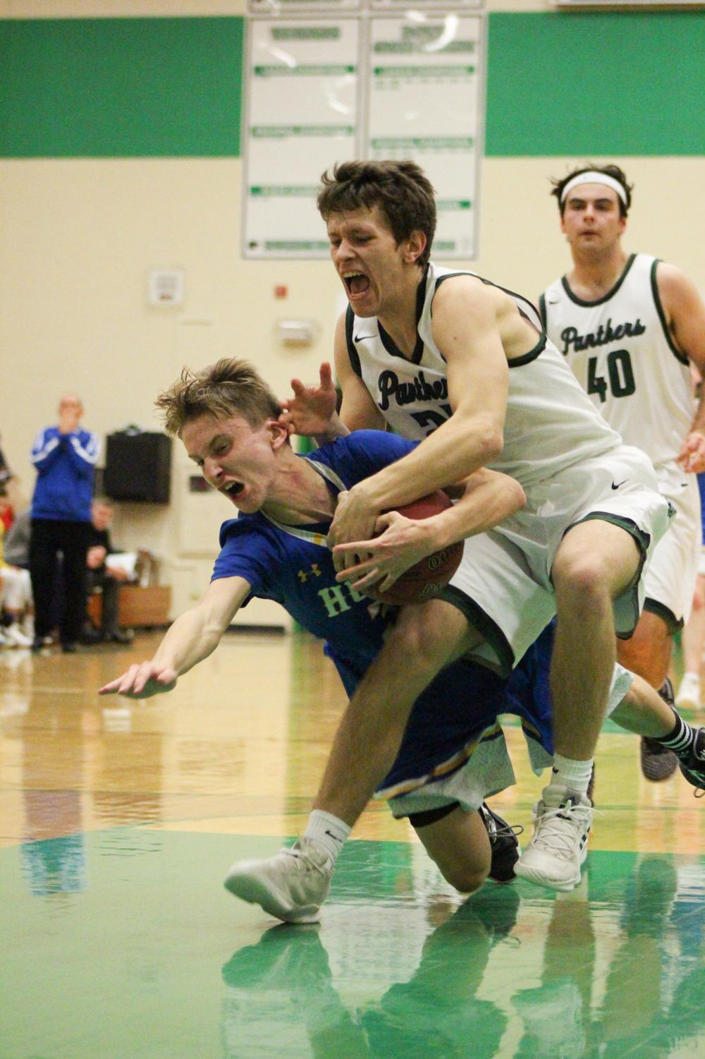 Senior Clayton Hood moves to get the ball from his Hutchinson opponent. The Panthers defeated the Salthawks 55-38.