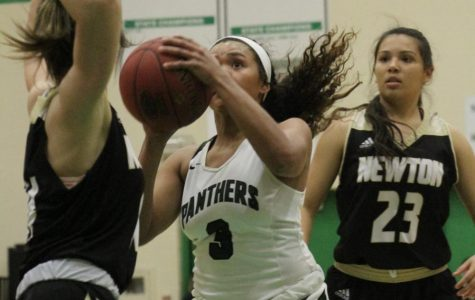 2/8 girls basketball vs. Newton photo gallery by Grace Reich