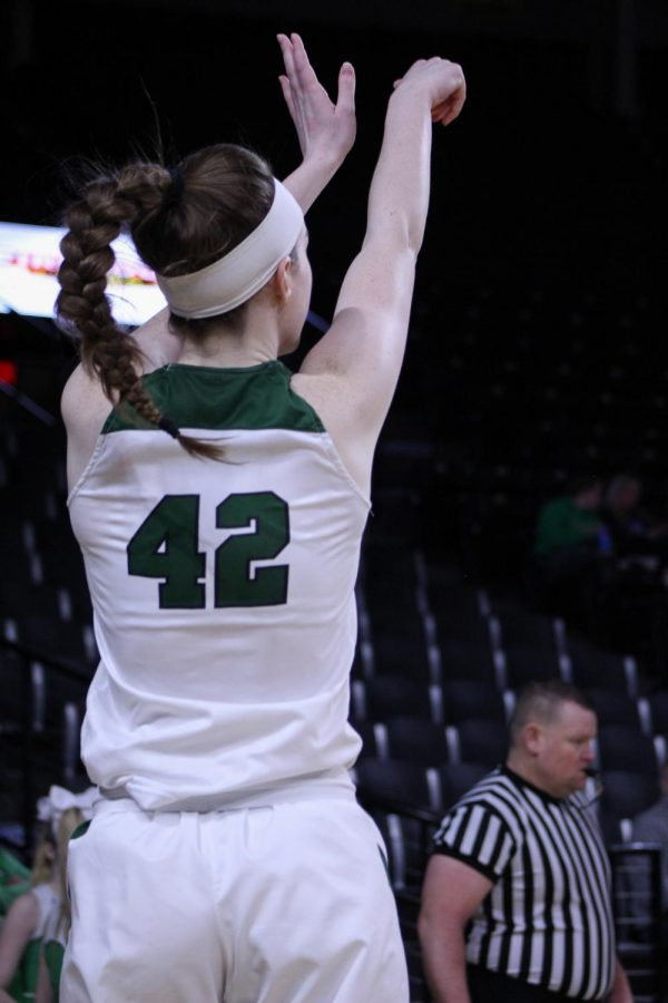 Senior+Kennedy+Brown+drills+a+three.+The+Panthers+defeated+Shawnee+Mission+Northwest+60-27+in+the+quarterfinals+round+of+the+Class+6A+State+Championship+Games.%0A