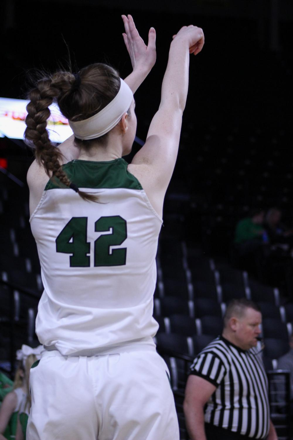 Senior Kennedy Brown drills a three. The Panthers defeated Shawnee Mission Northwest 60-27 in the quarterfinals round of the Class 6A State Championship Games.