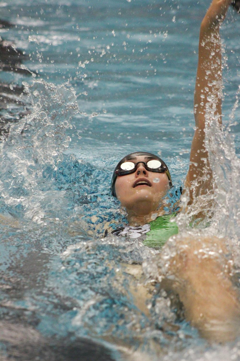 Sophomore Alexis Pitts swimming in the 100 yard backstroke.