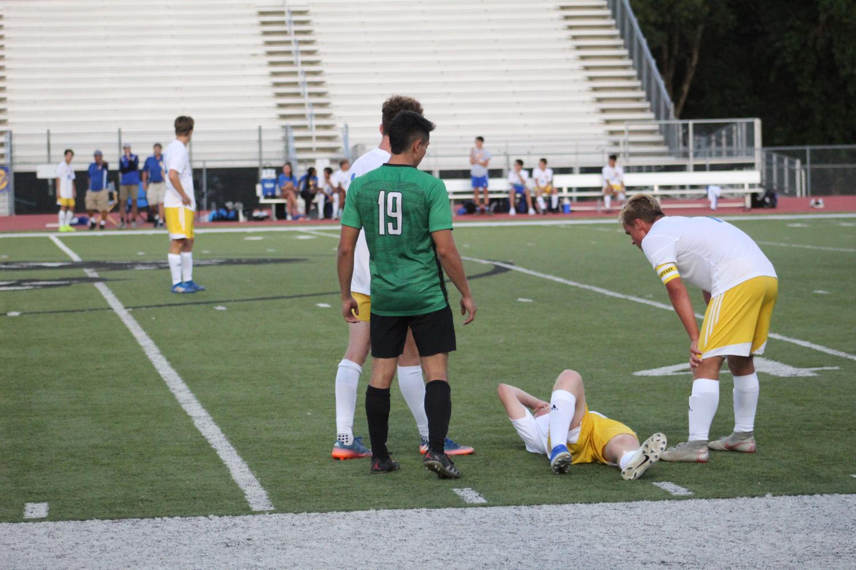 Senior+Saul+Munoz+helping+an+injured+Northwest+player