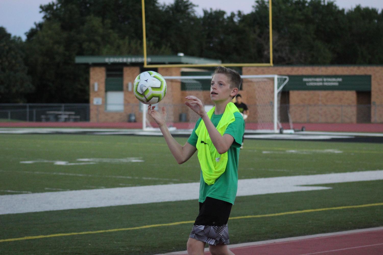 A+ball+boy+spinning+a+soccer+ball