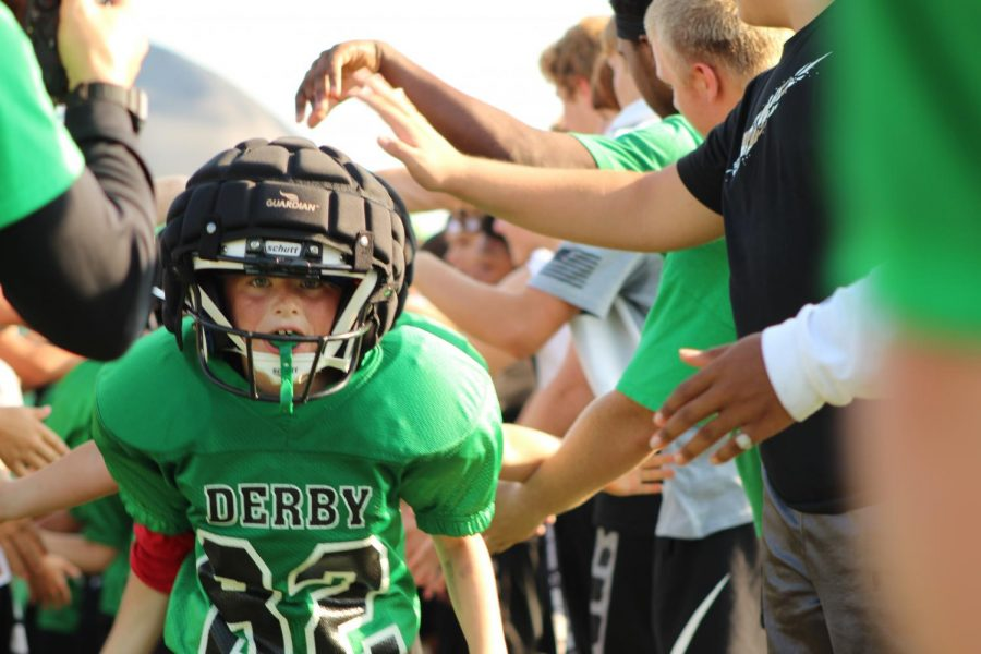 Derby+Jr.+Football+kids+run+through+the+tunnel+to+mark+the+beginning+of+their+game.