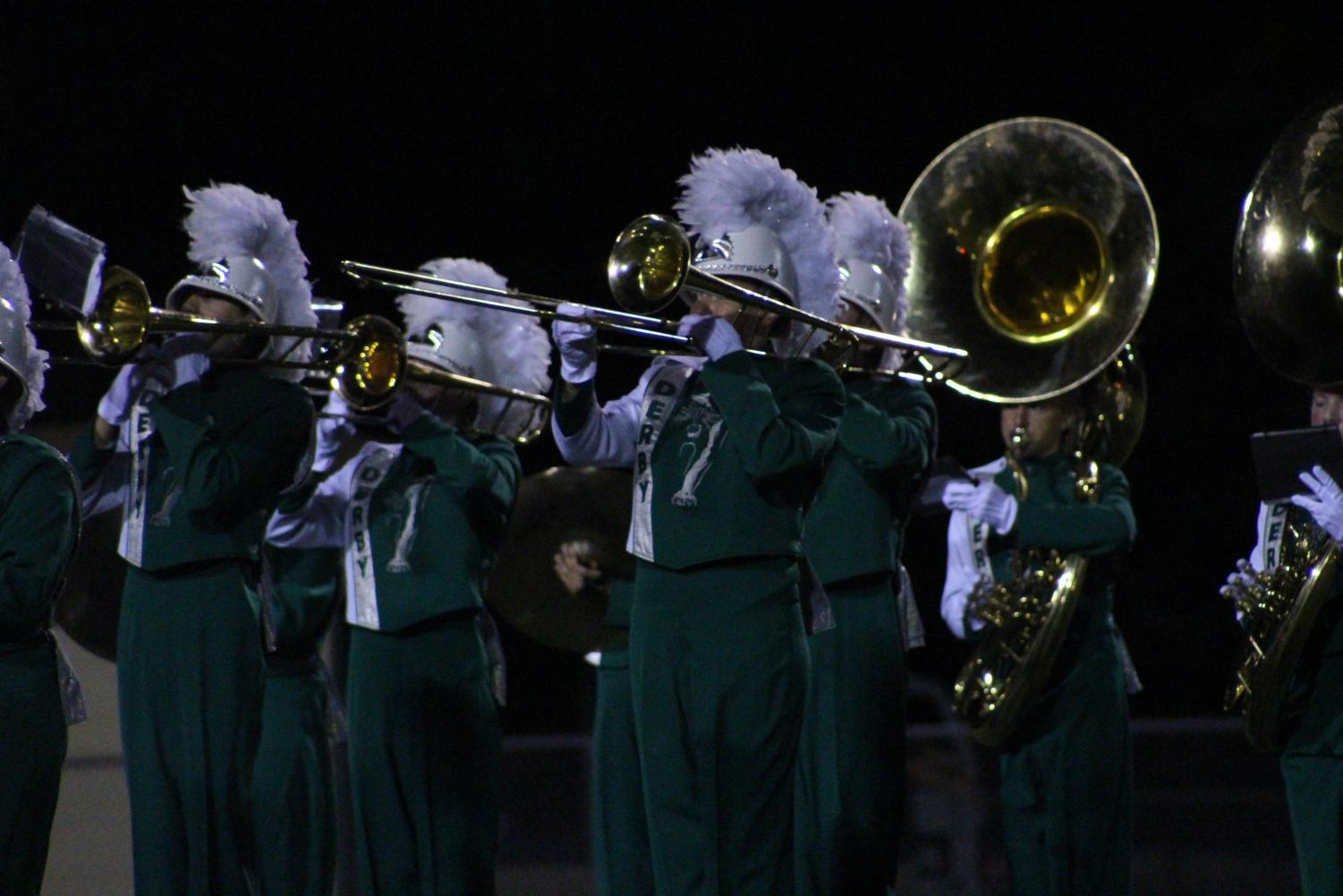 Trombone+players+in+the+marching+band+perform+at+halftime