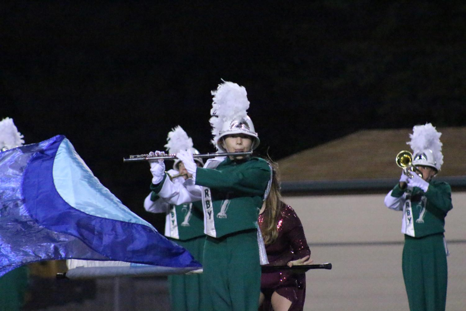 A+flute+player+performs+during+halftime+with+colorguard
