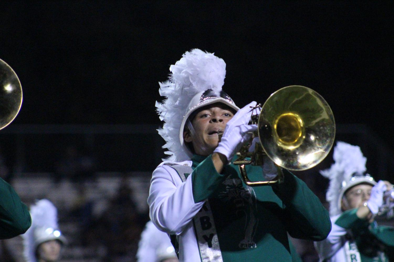 A+trumpet+player+takes+a+breath+while+playing+during+halftime