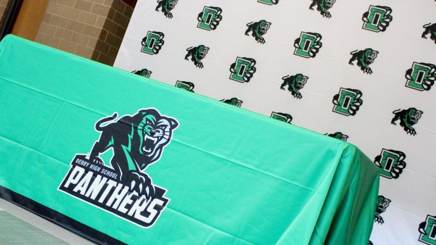 The table cloth and media backdrops are part of the merchandise provided by VIP Branding.