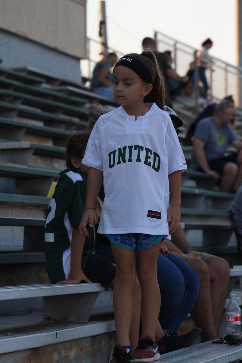 Young+Derby+supporter+stands+with+her+family+to+support+the+Derby+soccer+team.