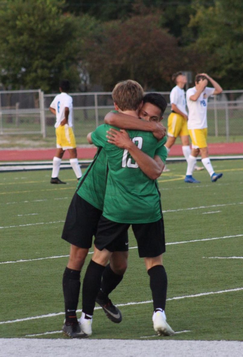 Derby+soccer+players+hug+after+scoring+a+goal+in+the+second+half+of+the+game.+