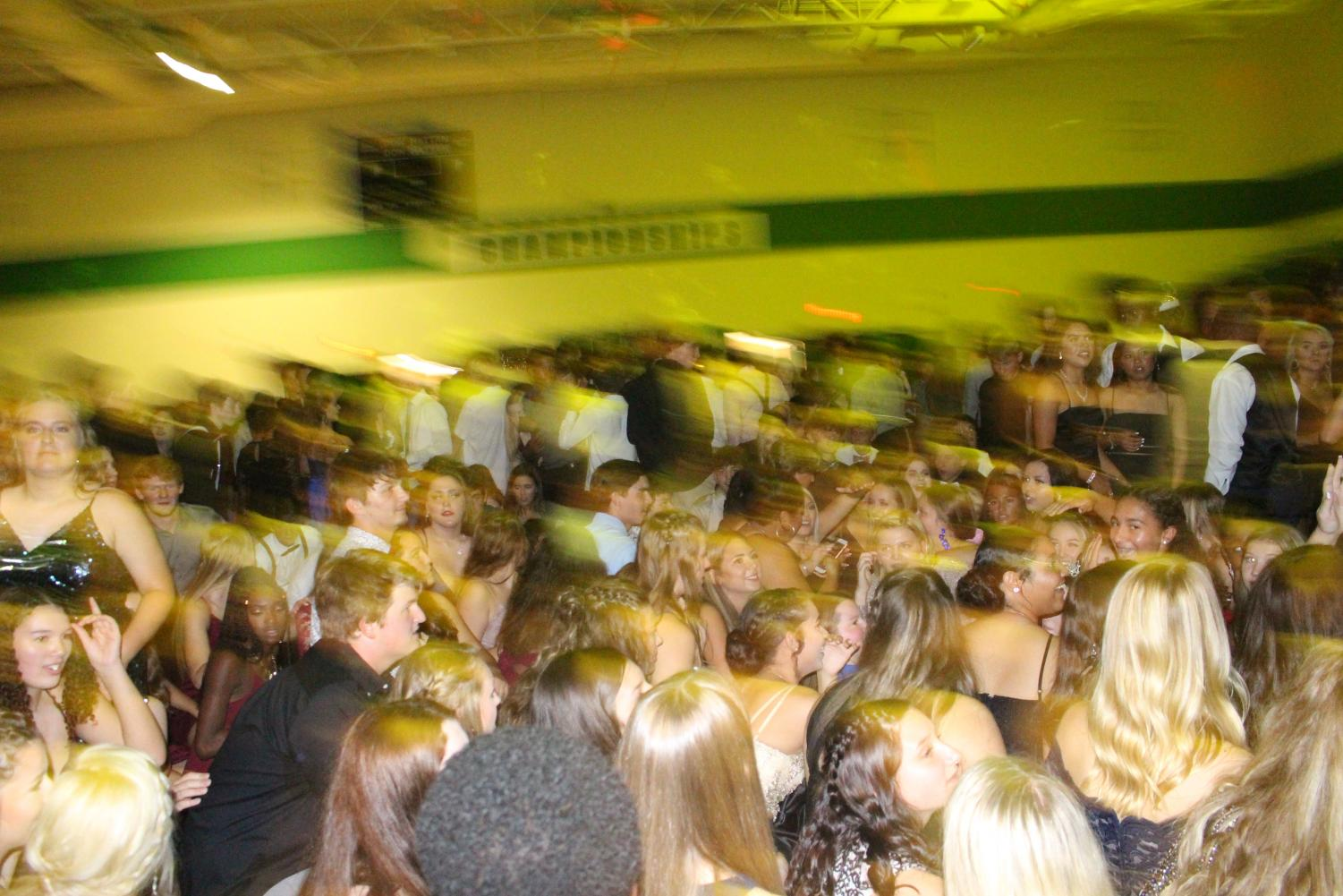 People+on+the+dance+floor+get+low+to+the+ground+to+tell+the+DJ+to+change+the+music.