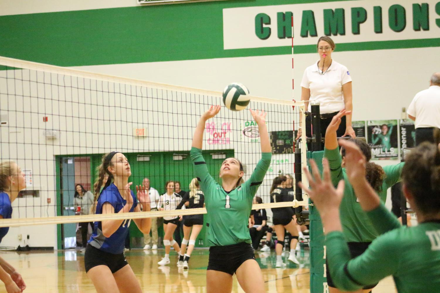 Senior+Sydney+Nilles+sets+the+ball+in+the+second+set+against+Washburn+Rural
