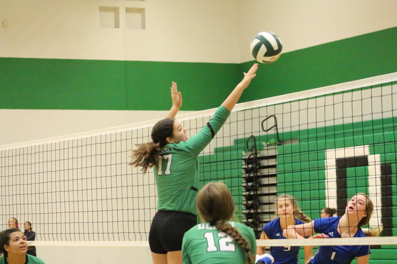 Junior+Antigone+Colon+jumps+up+and+blocks+the+ball+in+the+second+set+against+Washburn+Rural
