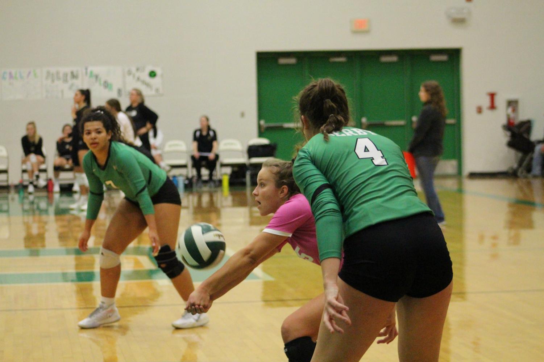 Senior+Heather+Mills%2C+libero%2C++bumps+the+ball